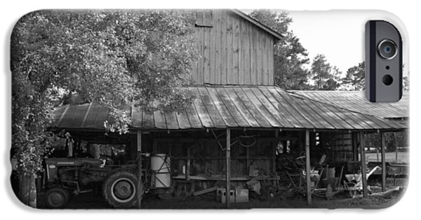 Old Barn Poster Photographs iPhone Cases - Barn with Farmall Tractor iPhone Case by Suzanne Gaff