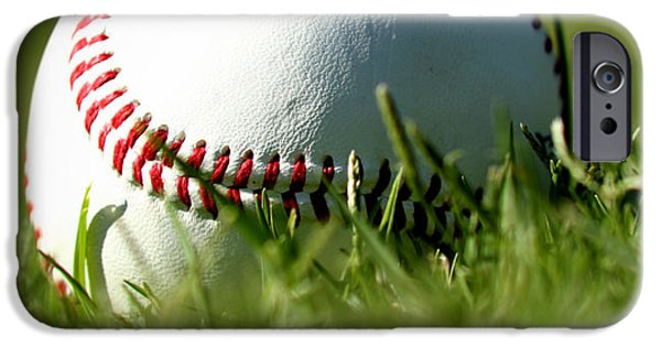 Sports Photographs iPhone Cases - Baseball in Grass iPhone Case by Chris Brannen