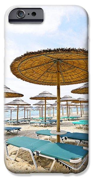Beach umbrellas and chairs on sandy seashore iPhone Case by Elena Elisseeva
