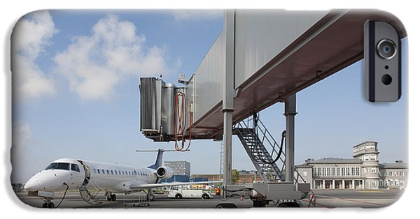 Airline Industry iPhone Cases - Boarding Bridge Leading to a Parked Plane iPhone Case by Jaak Nilson