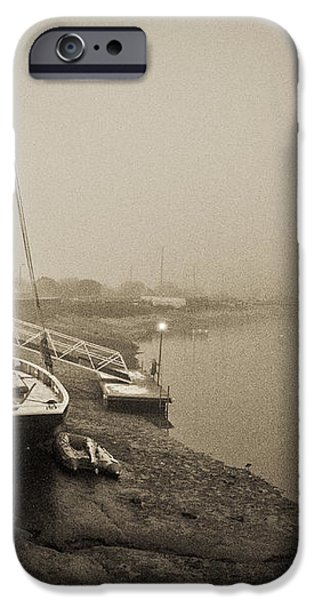 Boat on wintry quay iPhone Case by Gary Eason