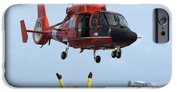 Law Enforcement iPhone Cases - Boatswain Mate Directs A Hh-65a Dolphin iPhone Case by Stocktrek Images