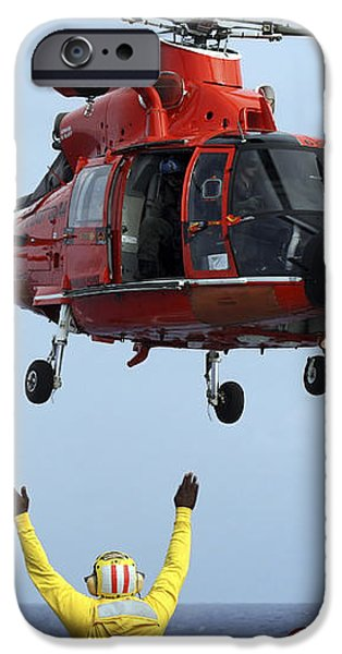 Boatswain Mate Directs A Hh-65a Dolphin iPhone Case by Stocktrek Images