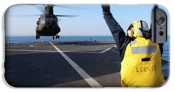 Raised Image iPhone Cases - Boatswains Mate Signals To A Ch-47 iPhone Case by Stocktrek Images