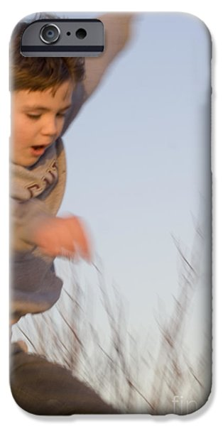 Boy jumping off sand dune iPhone Case by Christopher Purcell