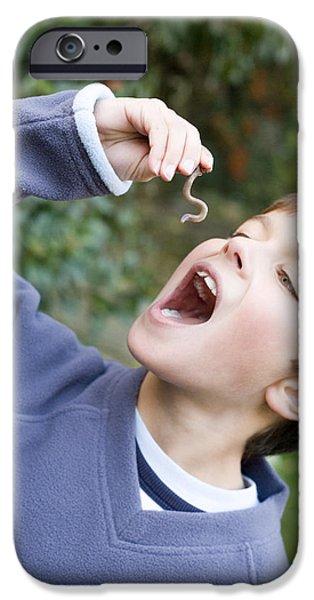 Boy Pretending To Eat An Earthworm iPhone Case by Ian Boddy