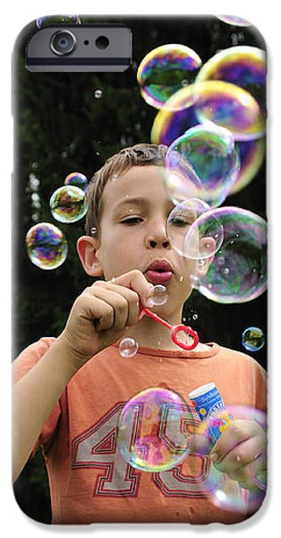 Boy with colorful bubbles iPhone Case by Matthias Hauser