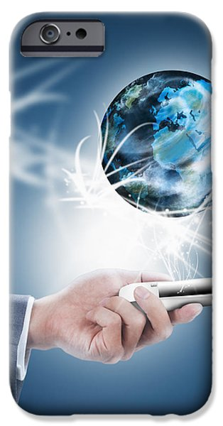 Technology iPhone Cases - Businessman Holding Mobile Phone With Globe iPhone Case by Setsiri Silapasuwanchai