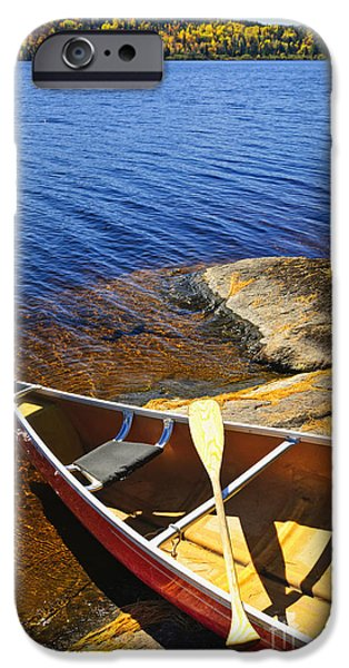 Canoes iPhone Cases - Canoe on shore iPhone Case by Elena Elisseeva