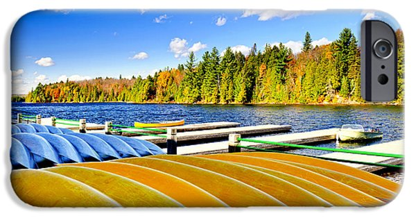 Canoes iPhone Cases - Canoes on autumn lake iPhone Case by Elena Elisseeva