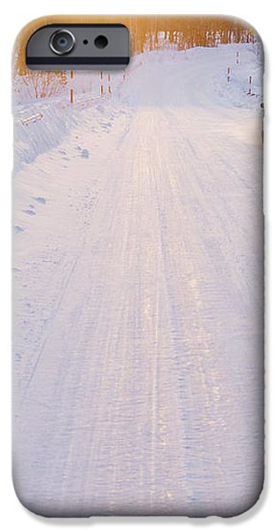Car on Snow Covered Road iPhone Case by Jeremy Woodhouse