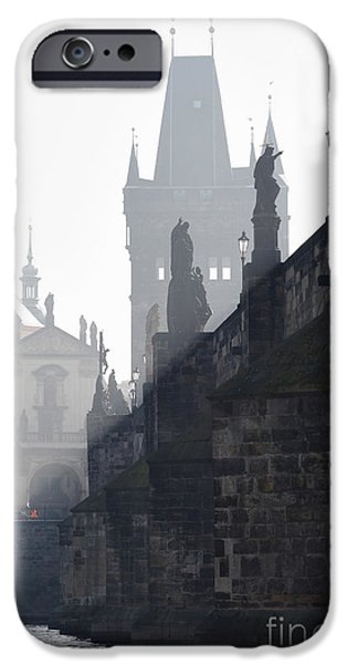 Charles bridge in the early morning fog iPhone Case by Michal Boubin