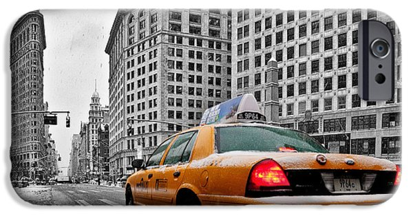 Winter Scene iPhone Cases - Colour Popped NYC Cab in front of the Flat Iron Building  iPhone Case by John Farnan