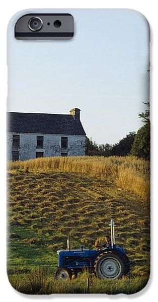 County Cork, Ireland Farmer On Tractor iPhone Case by Ken Welsh