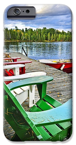 Deck chairs on dock at lake iPhone Case by Elena Elisseeva