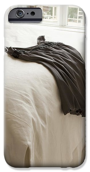 Dress Lying on Bed iPhone Case by Shannon Fagan