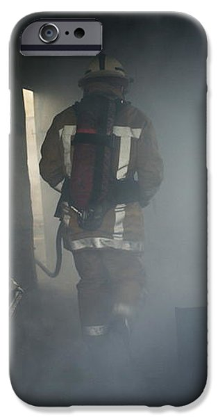 Fire Fighter In A Burnt House iPhone Case by Michael Donne