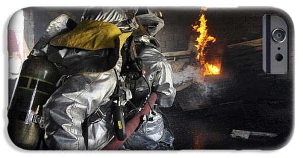 Baghdad iPhone Cases - Firefighters Extinguish A Fire iPhone Case by Stocktrek Images