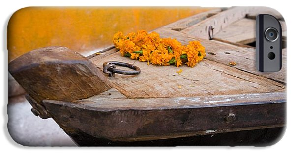 Canoe iPhone Cases - Flowers On Top Of Wooden Canoe iPhone Case by David DuChemin
