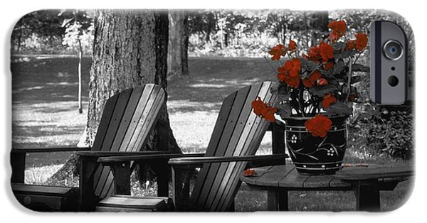 Empty Chairs iPhone Cases - Garden Chairs With Red Flowers In A Pot iPhone Case by David Chapman
