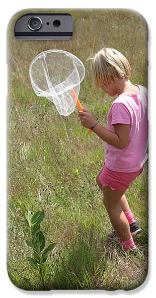 Girl Collecting Insects In A Meadow iPhone Case by Ted Kinsman