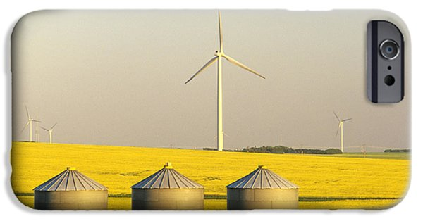 Canola Field iPhone Cases - Grain Bins And Wind Turbines In Canola iPhone Case by Dave Reede