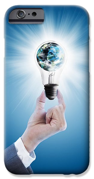 Technology iPhone Cases - Hand holding light bulb with globe  iPhone Case by Setsiri Silapasuwanchai