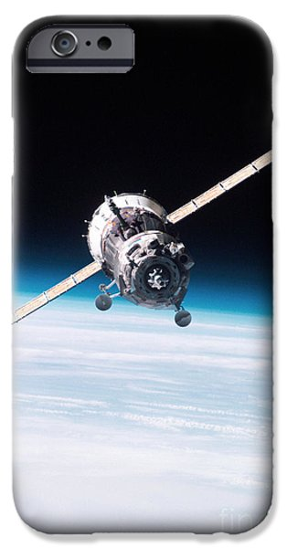 Iss Crew Arriving By Soyuz Spacecraft iPhone Case by NASA / Science Source