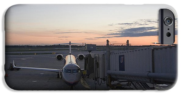 United Airlines Passenger Plane iPhone Cases - Jet bridge being attached to Canadair CRJ-200 iPhone Case by Christopher Purcell