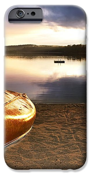 Lake sunset with canoe on beach iPhone Case by Elena Elisseeva