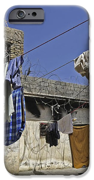 Laundry Hangs In The Courtyard iPhone Case by Stocktrek Images
