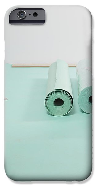 Laying A Floor. Rolls Of Underlay Or iPhone Case by Magomed Magomedagaev