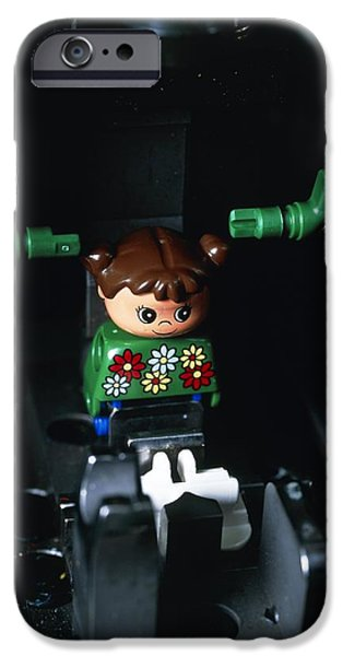 Lego Doll In An Assembly Machine iPhone Case by Volker Steger