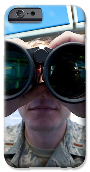 Lieutenant Uses Binoculars To Scan iPhone Case by Stocktrek Images