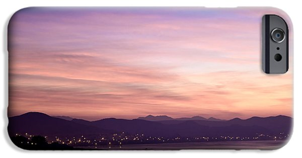 Beach At Night iPhone Cases - Lights Emanating From City in Distance iPhone Case by David Buffington
