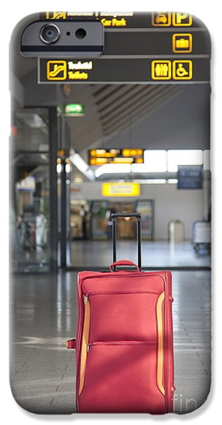 Airline Industry iPhone Cases - Luggage Sitting Alone in an Airport Terminal iPhone Case by Jaak Nilson