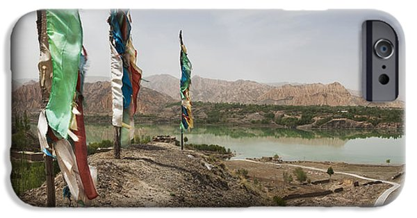 Tibetan Buddhism iPhone Cases - Lunda Poles Near Yellow River. View iPhone Case by Phil Borges