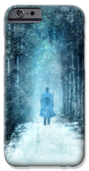 Wintertime iPhone Cases - Man Walking Through Snowy Woods iPhone Case by Jill Battaglia