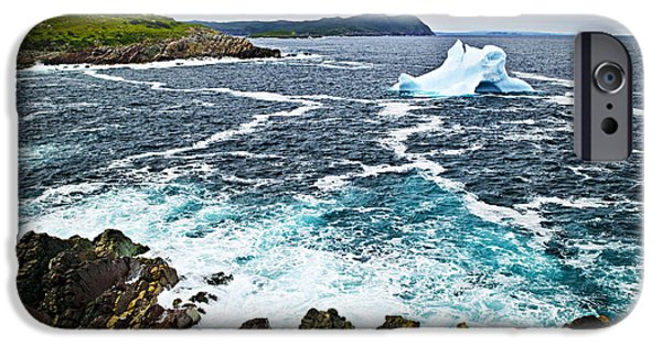 Drifting Snow Photographs iPhone Cases - Melting iceberg in Newfoundland iPhone Case by Elena Elisseeva