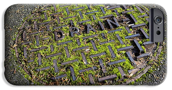 Asphalt iPhone Cases - Moss-Covered Manhole Cover iPhone Case by Paul Edmondson