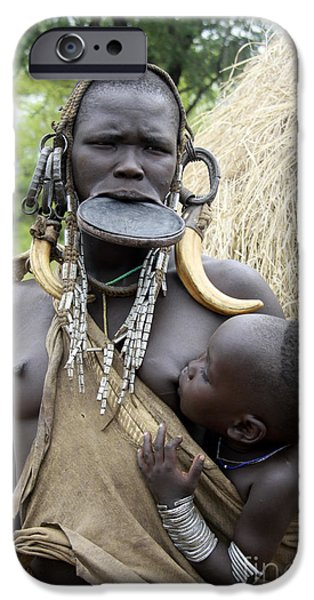 Ethiopian Woman iPhone Cases - Mursi tribe woman iPhone Case by Gilad Flesch