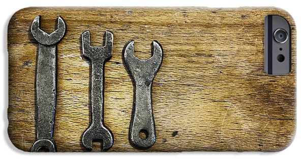 Work Tool iPhone Cases - Old Wrenches On Wooden Stool. Three Old iPhone Case by Marlene Ford