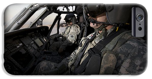 Cockpit Photographs iPhone Cases - Pilot In The Cockpit Of A Uh-60l iPhone Case by Terry Moore