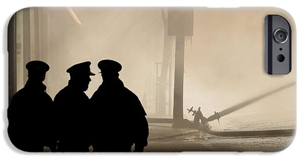 Police Officer iPhone Cases - Police watching firefighters during Moose Jaw New Years Fire iPhone Case by Mark Duffy