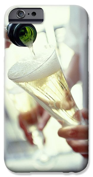 Pouring Champagne iPhone Case by David Munns