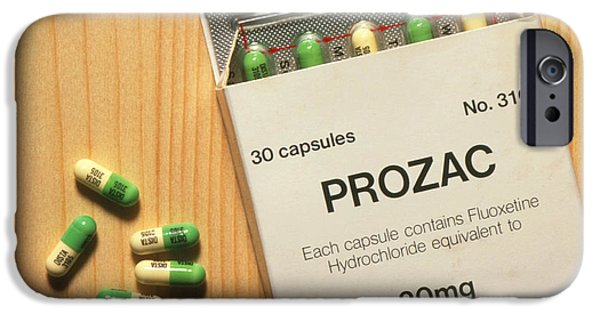 Antidepressant iPhone Cases - Prozac Pack With Pills On Wooden Surface iPhone Case by Damien Lovegrove