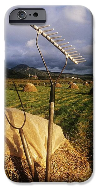 Rake With A Pitchfork On Hay In A iPhone Case by The Irish Image Collection