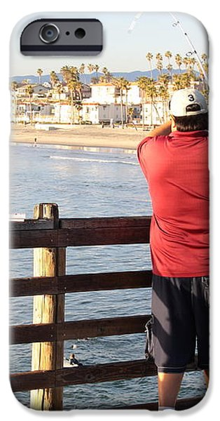 Reeling in a Big One at Oceanside Pier iPhone Case by Jim Vansant