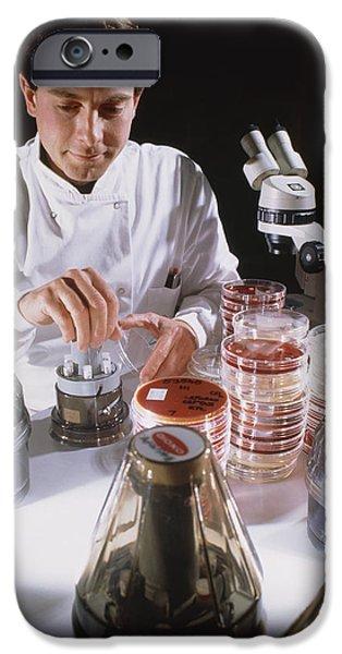 Sensitivity iPhone Cases - Researcher Testing The Sensitivity Of Bacteria iPhone Case by Geoff Tompkinson