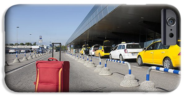 Airline Industry iPhone Cases - Rolling Luggage Outside an Airport Terminal iPhone Case by Jaak Nilson